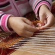 Child learns to weave — Stock Photo