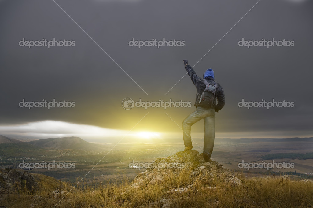 Man on peak of mountain. Conceptual design. — Stock Photo #7161413