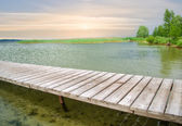 Wooden pier on beautiful lake — Stock Photo