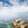 Rock in sea and blue sky. - Stock Photo