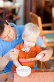 Father and son having breakfast — Stock Photo