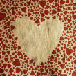 Vintage heart on old paper texture — Stock Photo