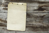 Vintage papier auf holz textur — Stockfoto