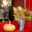 Stock Photo: Pumpkin and leaf bucket