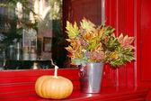 Pumpkin and leaf bucket — Stock Photo