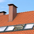 Tiled roof with a windows — Stock Photo