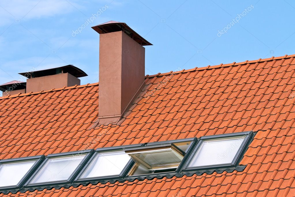 Tiled roof with a windows and chimney  Stock Photo #7003760