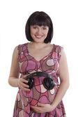 Mulher grávida com fones de ouvido na barriga. — Foto Stock