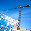 Lifting crane on building - Stock Photo