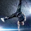 Young strong man break dance - Foto Stock