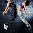 Young dancer couple jumping — ストック写真