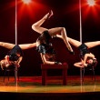 Three women acrobatic show — Stockfoto