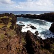 Easter Island rocky coast line under blue sky — Stock Photo