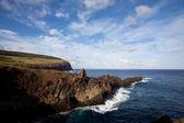 Easter Island rocky coast line under blue sky — Stock Photo