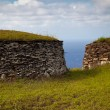 Ancient stone houses of Easter Island - Stock Photo