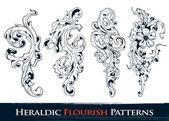 Set of heraldic flourish patterns — Stock Vector