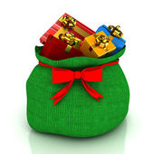 Christmas bag with gifts over white — Stok fotoğraf