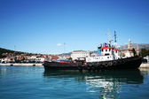 Working tug boat in port — Stock Photo