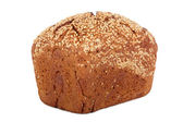 Baked rye bread with linseeds on the white isolated background — Stock Photo
