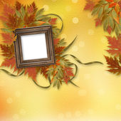 Bright autumn leaves on the abstract background with wooden fram — Foto de Stock