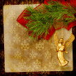 Angel christmas hanging on the pine branch. - Stock Photo