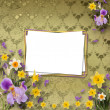 Stock Photo: Beautiful frame with irises and daffodils on the background the
