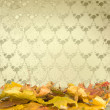 The fallen leaves on the background wall with vintage wallpaper — Stock Photo
