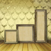 Wooden frames in the old room with the remains former luxury — Stock Photo