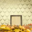The fallen leaves on the floor and wooden picture frames — Stock Photo