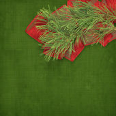 Christmas greeting card with branches of spruce and bows — Stock Photo