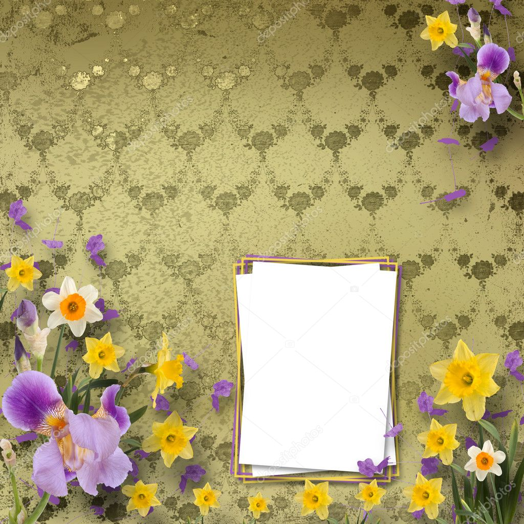 Beautiful frame with irises and daffodils on the background the wall with a pattern  Stock Photo #7413363