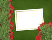 Christmas greeting card with branches of spruce and ribbons — Stock Photo
