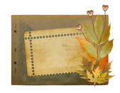 Grunge papers design in scrapbooking style with foliage and hear — Stock Photo