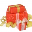 Holiday gift boxes decorated with bows and ribbons isolated on w — Stock Photo