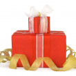 Stock Photo: Holiday gift boxes decorated with bows and ribbons isolated on w