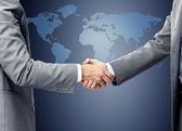 Handshake over world map — Stock Photo