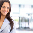 A young, pretty caucasian business woman at office building — Stock Photo