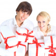 Young couple and gift - Stock Photo