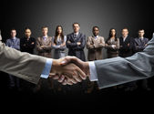 Handshake isolated on business background — Stock Photo