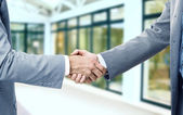 Photo of handshake of business partners after signing promising contract — Stock Photo