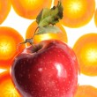 Red Apple on Carrot Background — Stock Photo