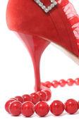Red Beads and Sexy Women's Shoe — Stock Photo