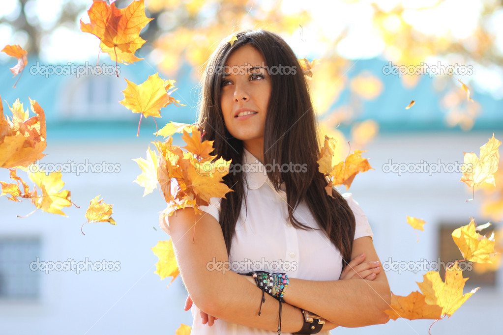 Portrait of a happy woman against yellow leaves — Stock Photo #7154204