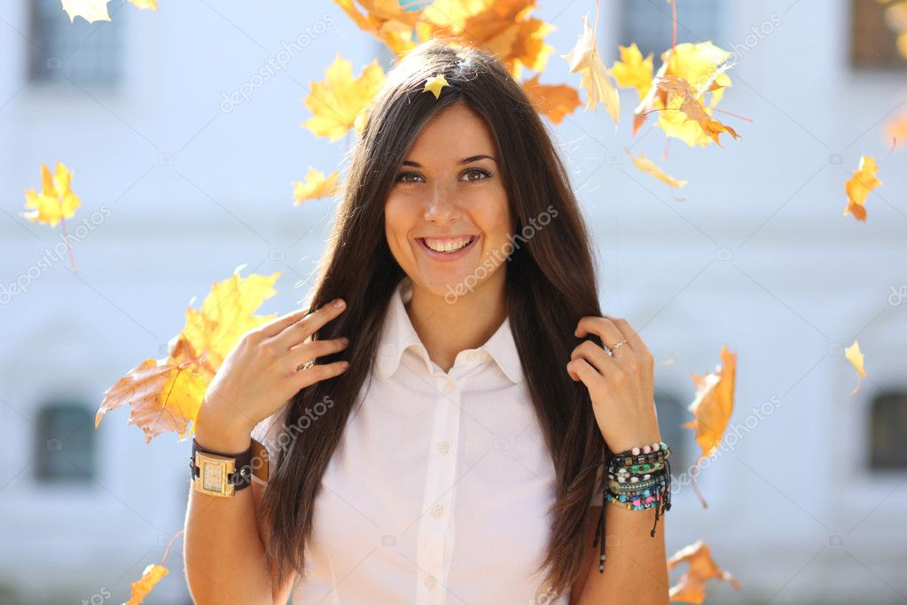 Portrait of a happy woman against yellow leaves — Stock Photo #7154206