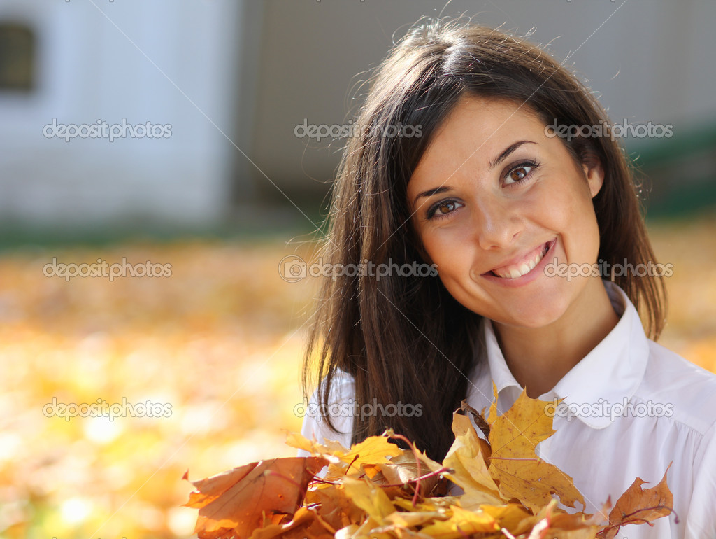 Young beautiful girl with a bouquet of maple leaves  Stock Photo #7154226