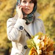 Stock Photo: Happy woman calling by phone