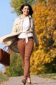 Walking woman in autumn park — Stock Photo