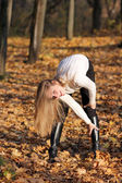 Walking woman in autumn park — Stock Photo