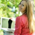Blond having fun with laptop — Stock Photo