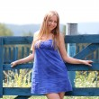 Beautiful young woman in blue dress - Stock Photo